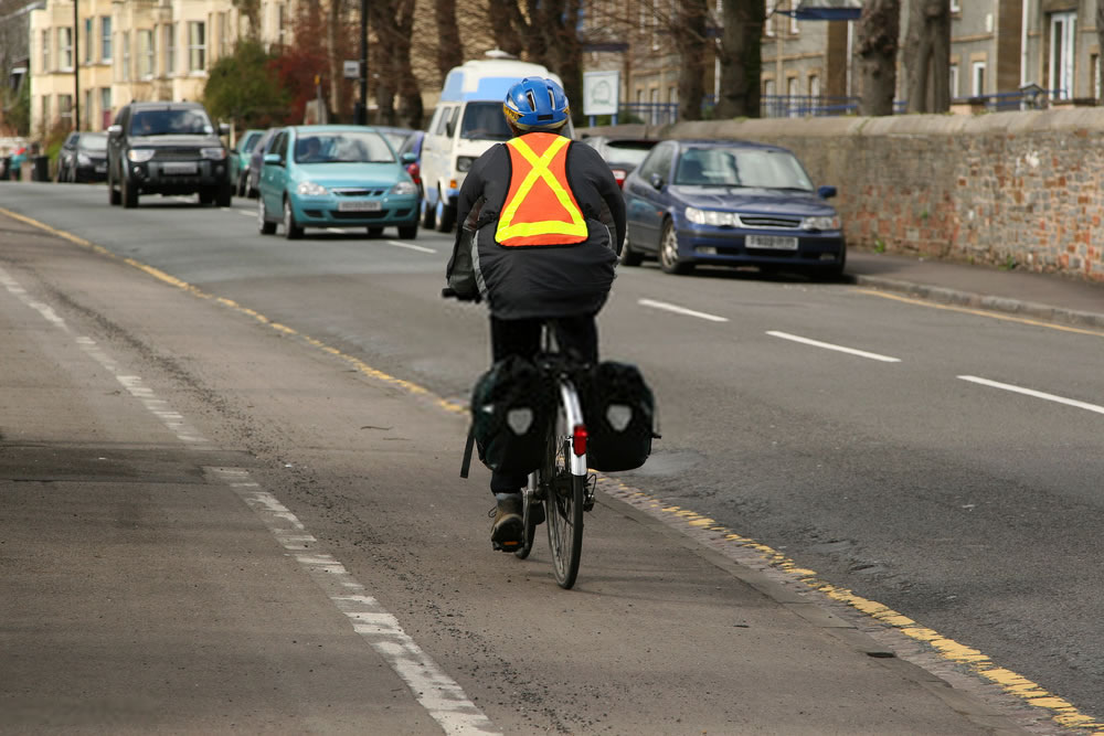 cyclists with reflective safety vest